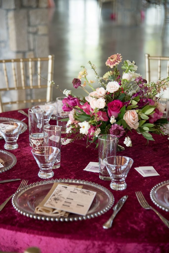 Spring Wedding Inspiration with monochromatic pinks on burgundy velvet linens at Stonehem Hall